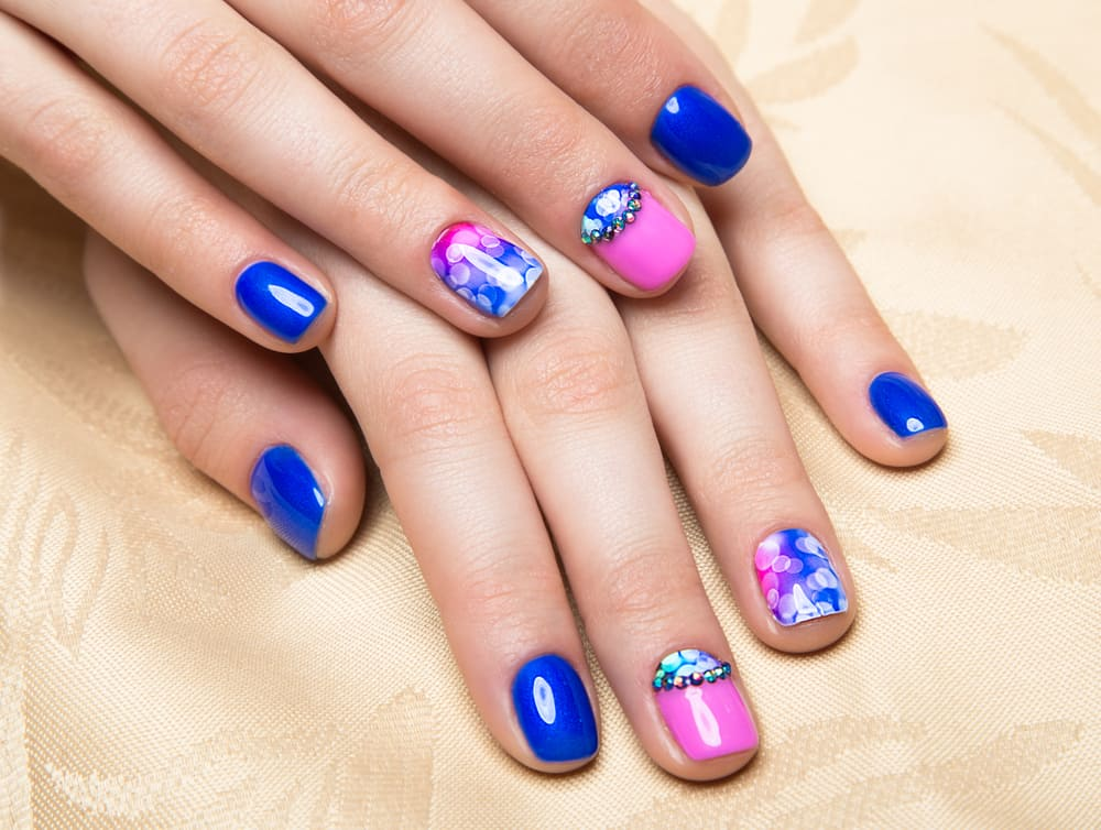 Beautiful colorful manicure with bubbles and crystals