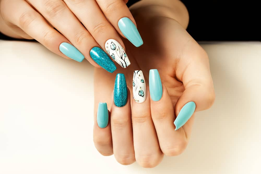 Blue female nails elongated with a design