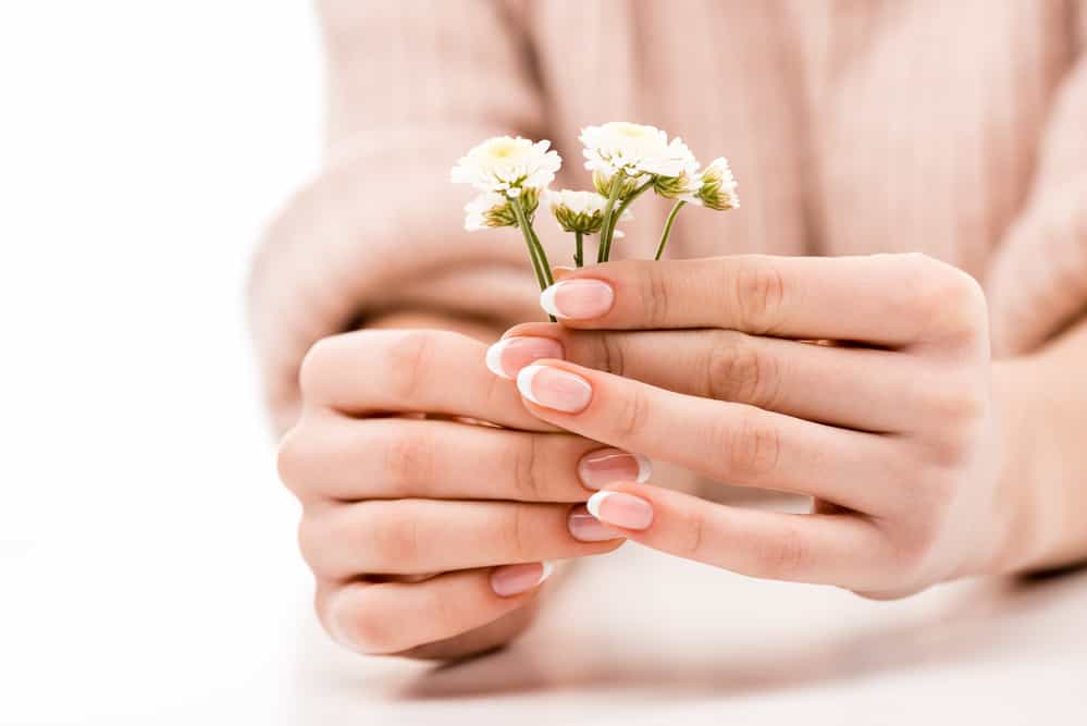 Cropped view of girl with natural manicure