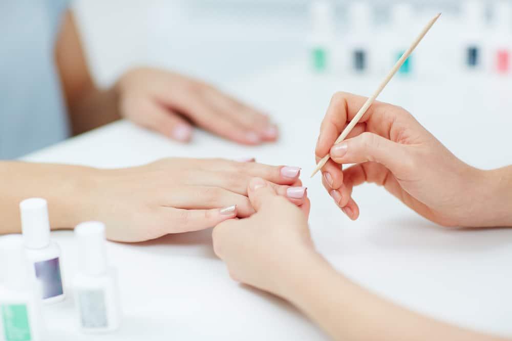 Female hands receiving a manicure