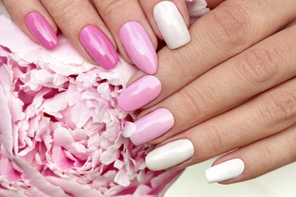 Light pink, pastel manicure on various shapes of nails