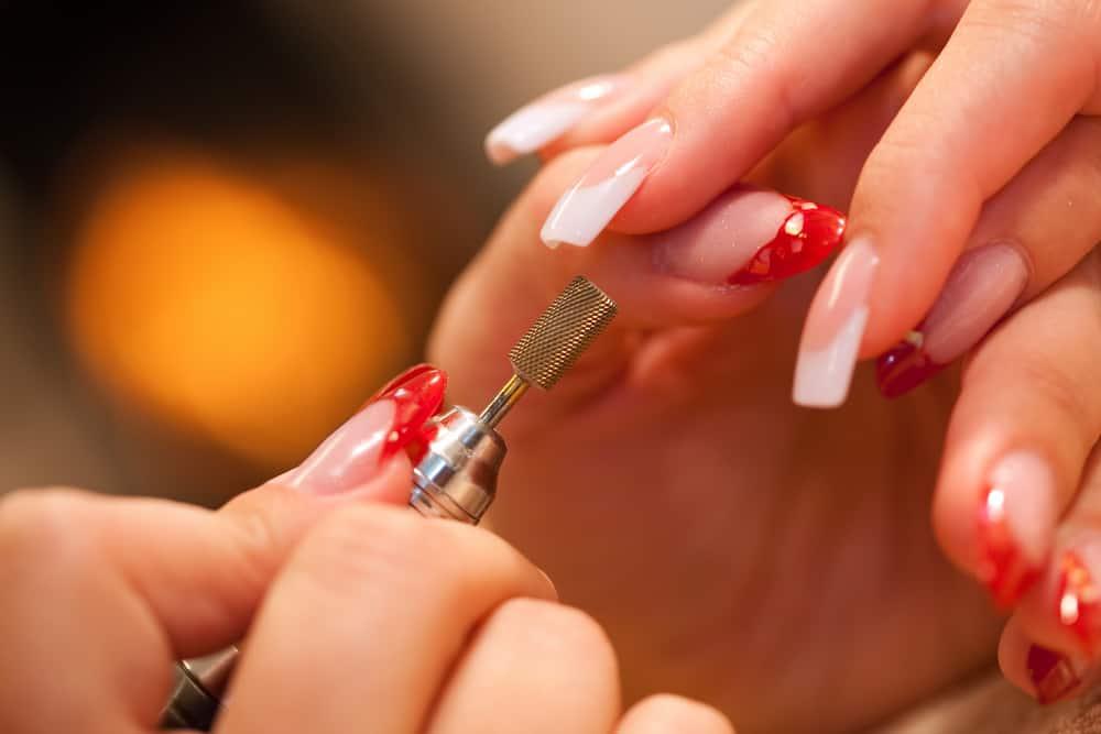 Macro closeup of nail polisher at work