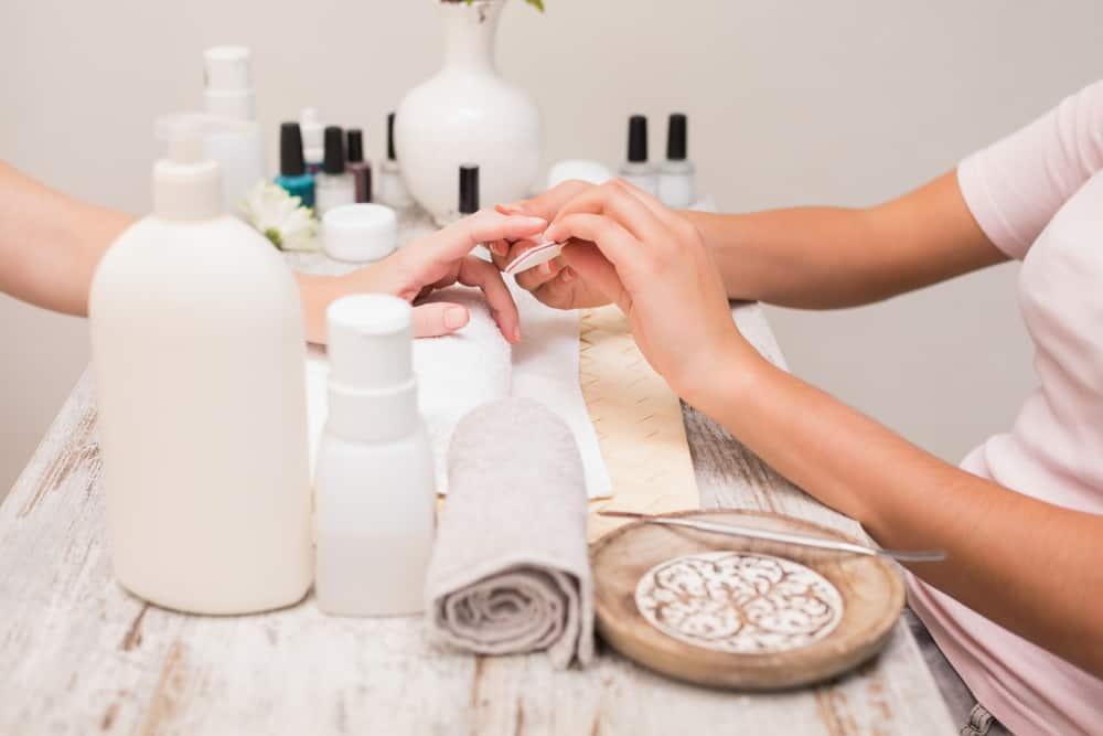 Nail technician giving custome manicure
