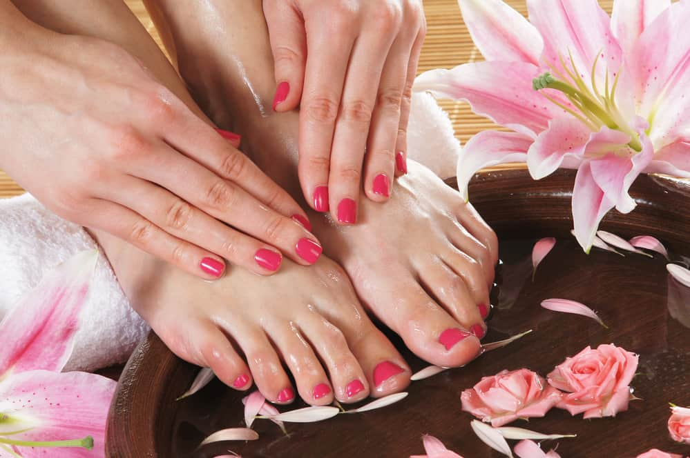 Spa background with a beautiful legs and flowers