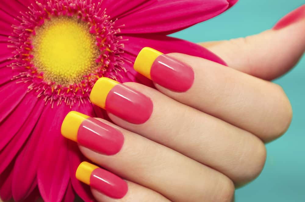 Two-tone manicure with pink and yellow varnish