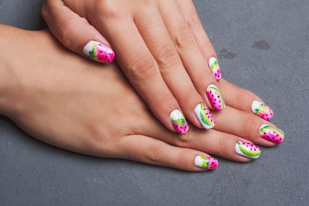 Watermelon nail art on gray background