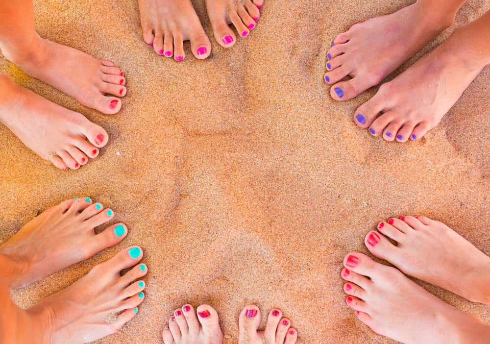 Woman feet on the sand