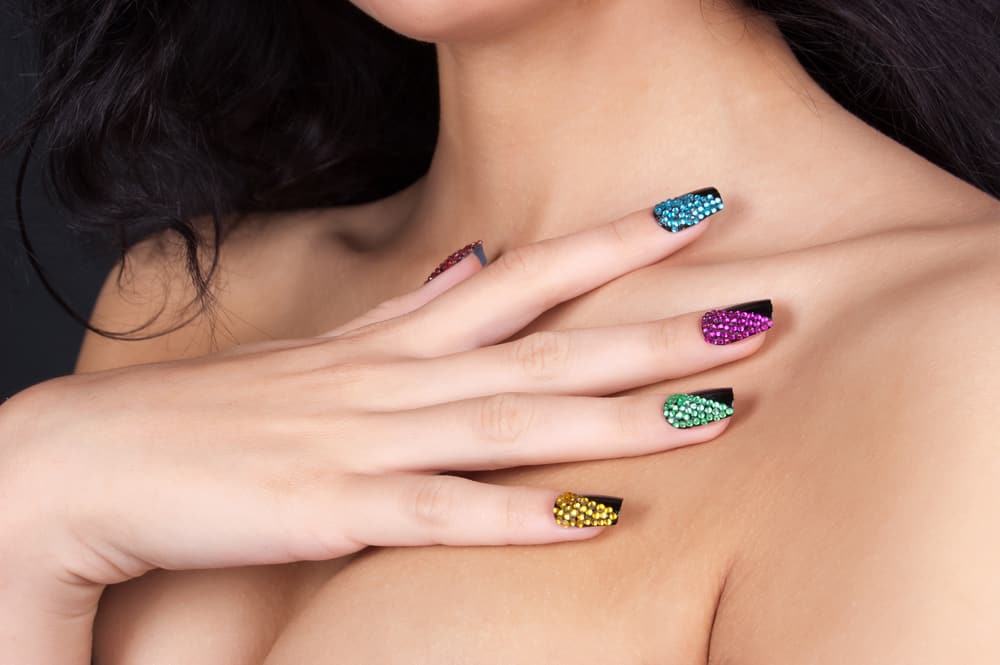 Beautiful young woman with fashion make-up and manicure
