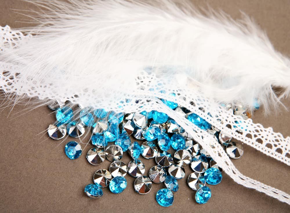 Blue rhinestones and white lace for decoration