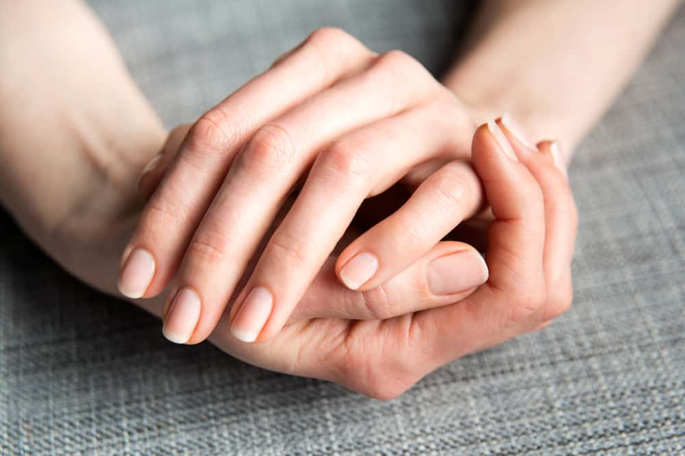 Female Hands on Gray Background